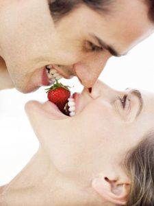 54f5fb6753547 1 couple sharing strawberry lgn 1 225x300 1