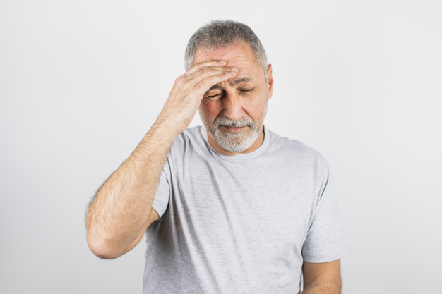 aged man pain holding his head 23 2148036826